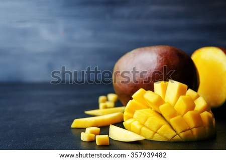 mango on a black background. tinting. selective focus  - stock photo