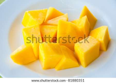 Mango on white dish : Most popular and delicious Thai fruit - stock photo