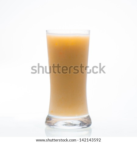 Mango shake drink in glass isolated on white background