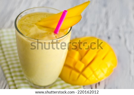 Mango shake in a glass selective focus - stock photo