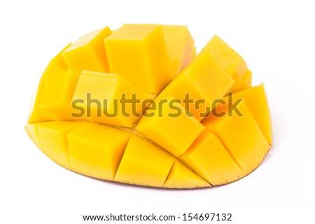 Mango slice cut to cubes close-up isolated on white background - stock photo
