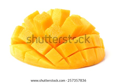 Mango slice cut to cubes close-up isolated on white background - stock photo