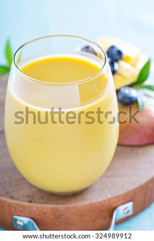 Mango smoothie fresh and bright on a board