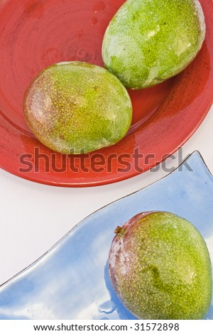 Mango tropical fruit assortment on red and blue plates