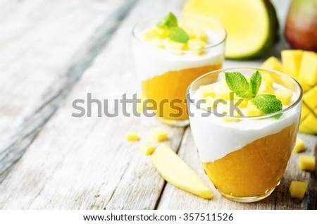 mango vanilla whipped cream dessert on white wood background.toning. selective Focus - stock photo