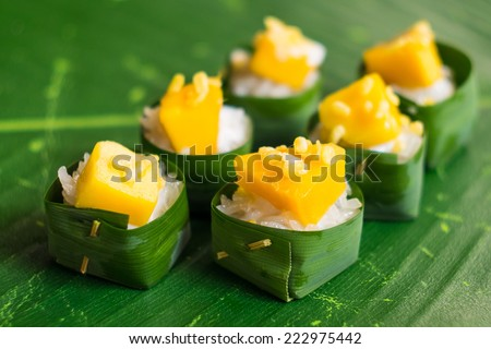 mango with sticky rice in banana leaf - stock photo