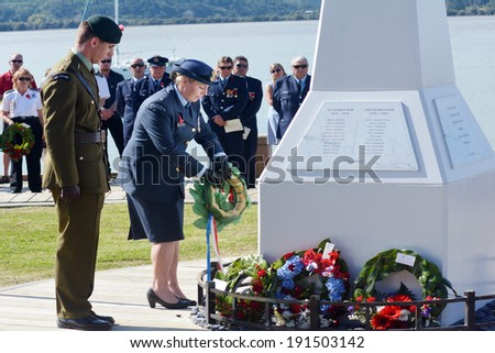 MANGONUI, NEW ZEALAND - APRIL 25 2014:New Zealand Army officers placing flower wreaths on Mangonui war memorial during Anzac Day War Memorial Service. - stock photo