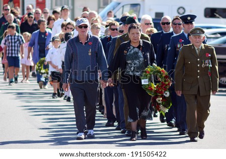 MANGONUI, NEW ZEALAND - APRIL 25 2014: New Zealanders and New Zealand Army veterans and officers march at the opening of the National War Memorial Anzac Day in New Zealand. - stock photo