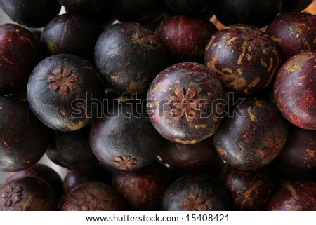 Mangosteen fruit for sale in an Asian market. - stock photo