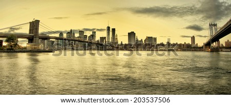 Manhattan and Brooklyn Bridges and Manhattan skyline At Night  - stock photo