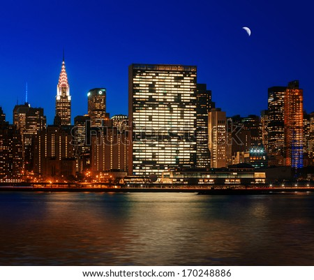 Manhattan at Night. New York City skyline with lights and reflections