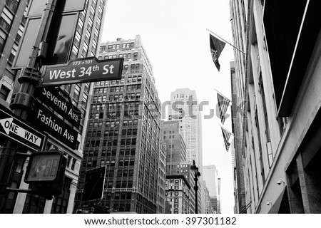Manhattan beautiful street view with big buildings and flags, New York, USA. Financial district. Business and travel background. Black and white postcard. - stock photo
