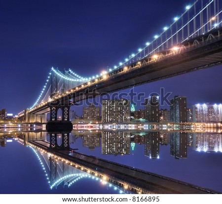 Manhattan Bridge and Manhattan skyline At Night Lights, NYC