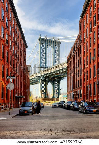 Manhattan Bridge from an alley in Brooklyn, New York - stock photo