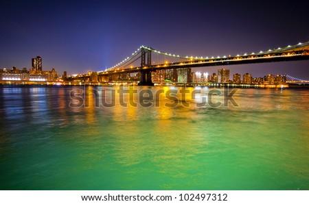 Manhattan Bridge in new York at nighttime - stock photo