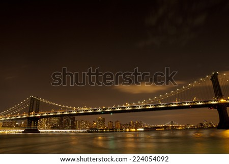 Manhattan Bridge in New York City at night - stock photo