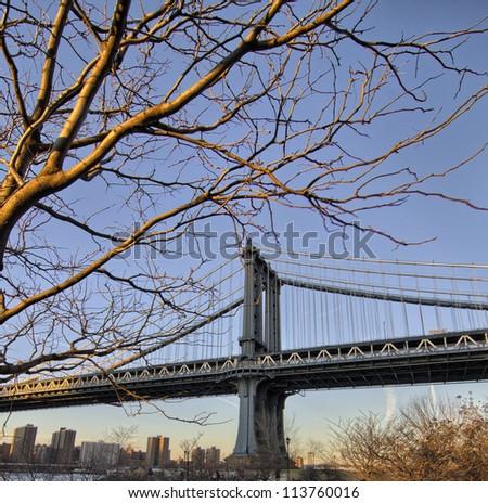 Manhattan Bridge in New York City - Winter sunset - stock photo