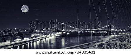Manhattan bridge looking from Brooklyn Bridge - stock photo