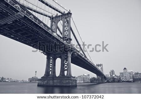 Manhattan Bridge, New York City. Image of the Manhattan Bridge with Brooklyn skyline in the background. - stock photo