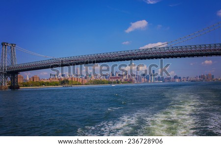 manhattan bridge taken from hudson river ferry with skyline in the background - stock photo