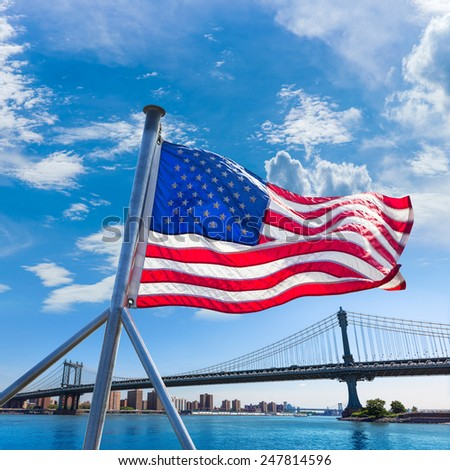 Manhattan Bridge with American flag from Brooklyn New York city US - stock photo