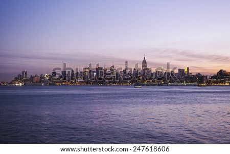 Manhattan circa dec 2014: Manhattan skyline an hudson river at sunrise view from new jersey  - stock photo
