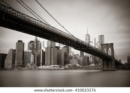 Manhattan financial district with skyscrapers and Brooklyn Bridge black and white. - stock photo