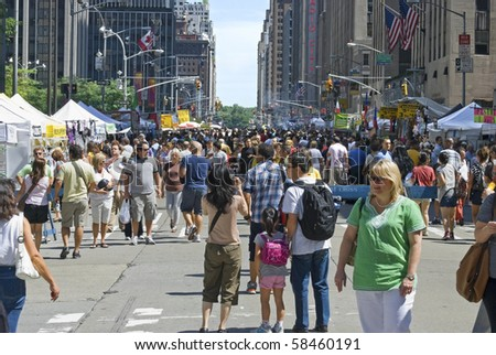 MANHATTAN - JULY 31:  Numerous street vendors and crowds line up Sixth Avenue for the Festival of the Americas on July 31, 2010 in Manhattan. - stock photo