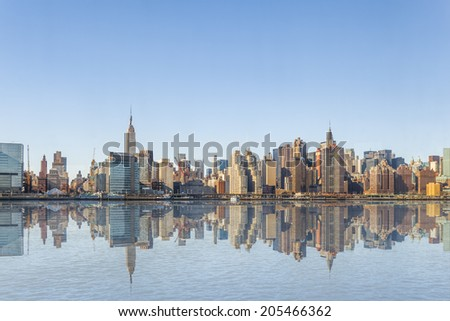 Manhattan midtown skyline panorama over East River in New York. - stock photo