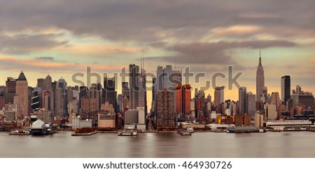 Manhattan midtown skyscrapers and New York City skyline at sunset