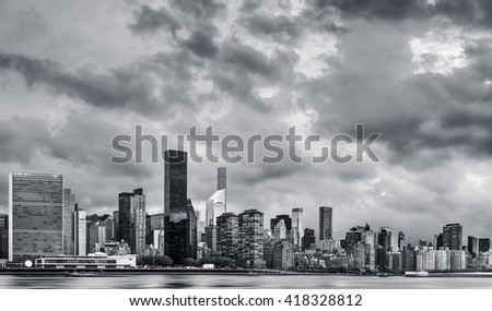 Manhattan, New York City. Black and white panoramic view of Midtown skyline across the East River - stock photo