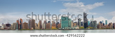 Manhattan, New York City. Panoramic view of Midtown skyline and the United Nations headquarters. View from Queens over the East River