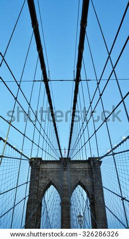 Manhattan, New York City, USA - March 11, 2014: a view of the Brooklyn Bridge with a clear blue sky. - stock photo