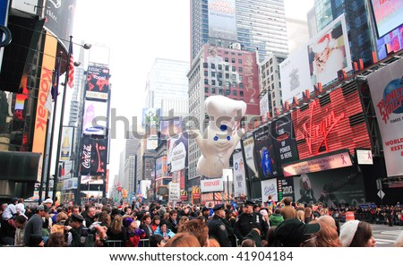 MANHATTAN - NOVEMBER 26 : A Pillsbury Doughboy balloon passing Times Square at the Macy's Thanksgiving Day Parade November 26, 2009 in Manhattan. - stock photo
