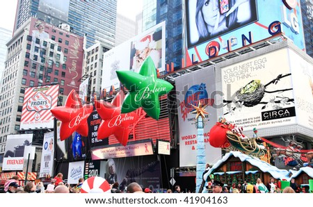 MANHATTAN - NOVEMBER 26: A Santa Clause passing Times Square at the Macy's Thanksgiving Day Parade November 26, 2009 in Manhattan. - stock photo