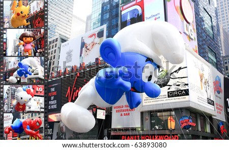 MANHATTAN - NOVEMBER 26: A Smurf balloon passes Times Square at the Macy's Thanksgiving Day Parade November 26, 2009 in Manhattan. - stock photo