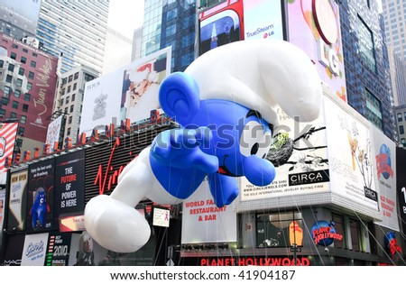 MANHATTAN - NOVEMBER 26: A Smurf balloon passing Times Square at the Macy's Thanksgiving Day Parade November 26, 2009 in Manhattan. - stock photo