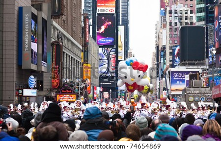 MANHATTAN - NOVEMBER 25 : Hello Kitty character balloon passing Times Square at the Macy's Thanksgiving Day Parade November 25, 2010 in Manhattan. - stock photo