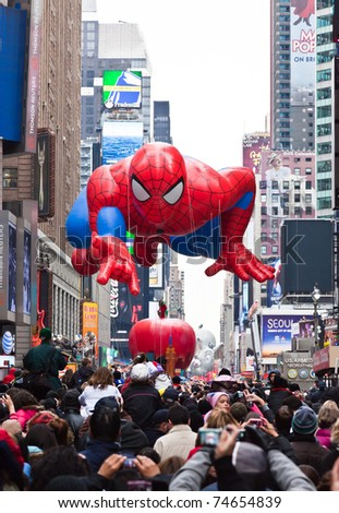 MANHATTAN - NOVEMBER 25 : Spider Man character balloon passing Times Square at the Macy's Thanksgiving Day Parade November 25, 2010 in Manhattan. - stock photo