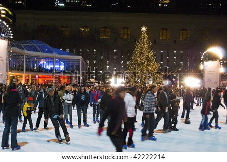 MANHATTAN, NY - DECEMBER 4: Hundreds gather at the skating pond at Bryant park for the annual Christmas tree lighting ceremony on December 4, 2009 in NYC. - stock photo