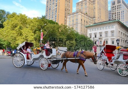 MANHATTAN, NY- SEPTEMBER 21: Central Park Horse Carriage Rides in Manhattan  New York, USA on September 21, 2013. One of the 5 boroughs of New York City, the smallest but also the most populated. - stock photo