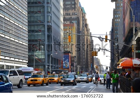 MANHATTAN, NY- SEPTEMBER 21: Manhattan streets, and architecture in New York, USA on September 21, 2013. One of the 5 boroughs of New York City, the smallest but also the most populated. - stock photo