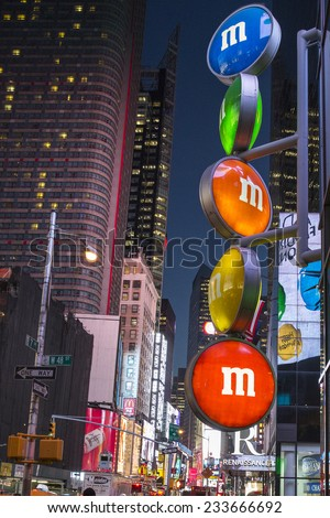 Manhattan, NYC - November 3: View of neon lights in Times Square by night, in Manhattan, NYC on November 3, 2014. - stock photo