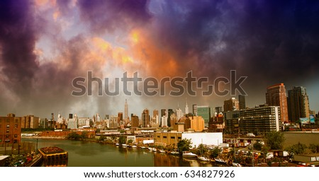 Manhattan, NYC. Stunning city skyline at summer sunset.