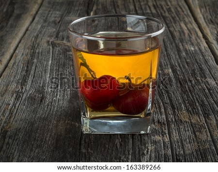 Manhattan or other whiskey cocktail, with cherries submerged - stock photo