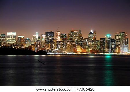 Manhattan over Hudson River, New York City skyline panorama with skyscrapers at dusk.