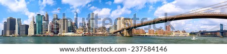 Manhattan skyline and Brooklyn Bridge panorama in New York City - stock photo