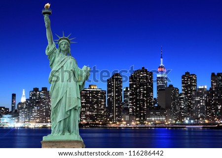 Manhattan Skyline and The Statue of Liberty at Night Lights, New York City - stock photo