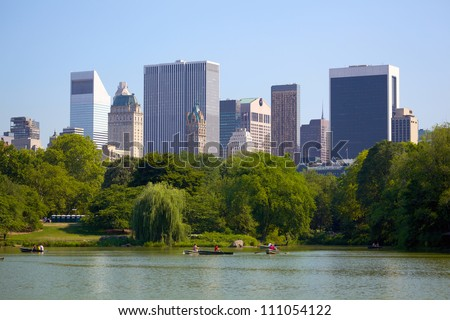 Manhattan skyline behind Central Park, New York City - stock photo