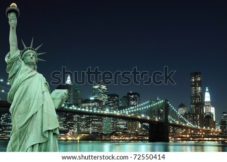 Manhattan Skyline, Brooklyn Bridge and The Statue of Liberty at Night Lights, New York City - stock photo